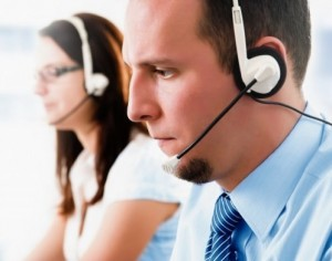 male and female agents on call with customers
